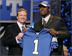 Calvin Johnson, right with commissioner Roger Goodell after the Lions made him the second overall pick in the NFL draft, is welcomed openly by the current crop of Detroit receivers.