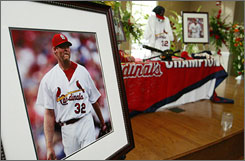 A photo of St. Louis pitcher Josh Hancock during his last baseball game before he was killed in an auto accident sits on a memorabilia table following a memorial service in Tupelo, Miss., on Thursday.