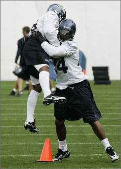 New teammates Josh Wilson and Deon Grant participate in their first mini-camp together as Seahawks in Kirkland, Wa.