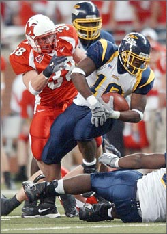 "Toledo's Harvey ""Scooter"" McDougle Jr., seen here carrying the ball during a 2004 game, had faced   federal charges of participating in a bribery scheme to influence games. Last month, however, the criminal complaint against the running back was dropped."