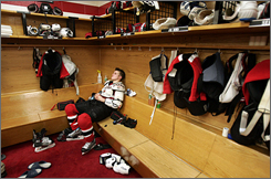 New Jersey's Zach Parise sits alone after the Devils' elimination from the Eastern Conference semis. USA Hockey senior director Jim Johannson praised Parise for joining the world team after such a loss.