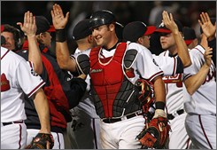 Atlanta's Jarrod Saltalamacchia, center, was a first-round pick in 2003, and now serves as reinforcement behind the Braves' All-Star catcher Brian McCann.