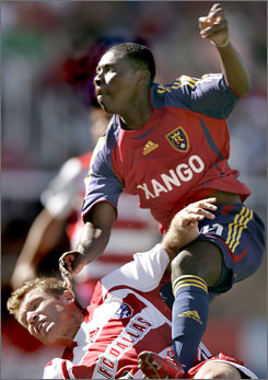 Real Salt Lake's Freddy Adu climbs over FC Dallas' Bobby Rhine during their MLS match last month.