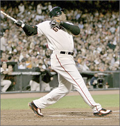 Doing his thing: Barry Bonds cracks No. 745 as the Giants play the Mets on Tuesday. The slugger needs 11 homers to pass Hank Aaron.
