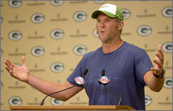 "Brett Favre spoke to the media after arriving at Packers minicamp on Friday. The quarterback disputed reports that he was unhappy in Green Bay. ""I don't think anyone can question my leadership and determination to win,"" he said."