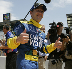 John Andretti gives two thumbs up after he successfully qualified for next weekend's Indy 500.