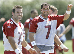Arizona's Matt Leinart, right, with fellow quarterback Kurt Warner, is hoping to flourish in his second season in the NFL but first under new Cardinals coach Ken Whisenhunt.