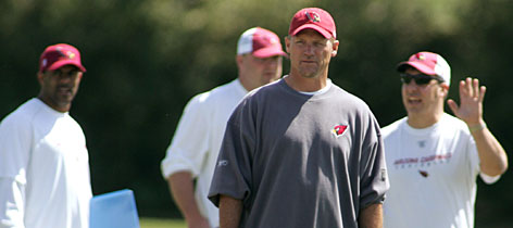 "New Arizona coach Ken Whisenhunt, center, is bringing a sense of optimism to the desert franchise that has won just one playoff game in 60 years and hopes to finally turn the corner. Whisenhunt is planning to change the football culture in Arizona. ""I see a team that wants to win,"" he says, ""but doesn't have a clear vision of how to do it."""