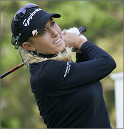 Natalie Gulbis eyes a tee shot during her pro-am round with a foursome that included former Philippines president Fidel V. Ramos. The LPGA star went on to finish in a tie for 17th at the event, forcing her to search for her first tour victory for at least another week.