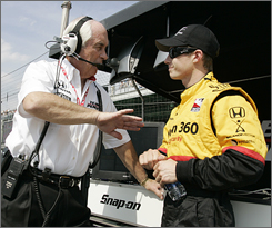 Ryan Briscoe, right, talking to Roger Penske, gets high marks from four-time Indy 500 champ Rick Mears, who's helping him prepare for Sunday's race.