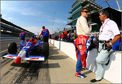 Marco Andretti talks strategy with his grandfather, Mario, during practice for the Indy 500. After finishing second at Indy in 2006, Andretti has had a rough start to the 2007 season. He finished fourth at St. Petersburg but has failed to finish the series' other three events.