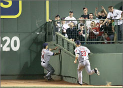 Cleveland center fielder Grady Sizemore, left, and right fielder Trot Nixon race to Fenway Park's Triangle to chase what became Kevin Youkilis' inside-the-park home run during Boston's 5-3 victory.