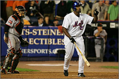 The New York Mets'   Carlos Delgado follows the flight of the ball which left the ballpark in the bottom of the 12th inning against San Francisco. The Mets won 5-4 for their fourth straight victory.