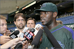 The Devil Rays' Elijah Dukes speaks with reporters before Tampa Bay's game against Detroit.