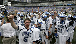 The Duke Blue Devils lacrosse team salutes their fans after dropping the NCAA Championship to Johns Hopkins. The seniors on the team have just been granted an extra year of eligibility.