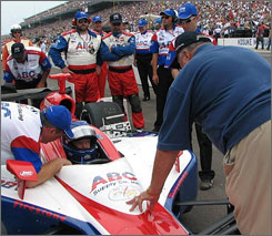 Car owner A.J. Foyt, right, talks with Al Unser Jr. before the start of the Indy 500.