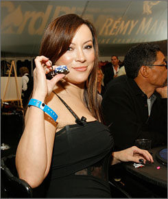 Actor and professional poker player Jennifer Tilly poses for photographers at the Urban Health Institute's second annual celebrity poker championship April 28 in Los Angeles.