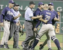 San Padres catcher Josh Bard is restrained by coaches Glenn Hoffman, third from right, and Craig Colbert, right; and umpire Ed Hickox. Plate umpire Ed Rapuano, second from left, has just ejected Bard after the men in blue overturned a home run call at PNC Park in Pittsburgh. Padres manager Bud Black, left, keeps an eye on his upset player.