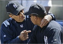 Yankees manager Joe Torre chats with Alex Rodriguez during spring training. Friday, Torre said A-Rod probably should not have distracted Blue Jays infielder Howie Clark on Wednesday.