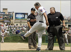 Cubs manager Lou Piniella kicks his hat during an eighth-inning argument with umpires that earned the Chicago skipper an ejection.