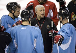 Senators coach Bryan Murray convenes Dany Heatley, Jason Spezza, and Daniel Alfredsson, left to right, during practice on Friday.