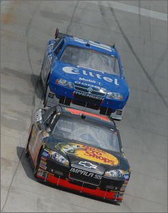 Martin Truex Jr. holds off Ryan Newman for the lead during Monday's Autism Speaks 400. Truex and Newman dominated the race and finished 1-2.