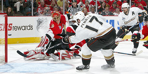 Dustin Penner scores the deciding goal of Game 4 in the Stanley Cup Finals off assists from Andy McDonald and Teemu Selanne. The shot on the Senators' Ray Emery gave the Ducks a 3-2 victory.
