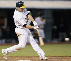 Oakland's Mark Ellis singles in the tenth inning against the Red Sox to complete the cycle. The four-hit performance came during a 5-4, 11-inning victory over Boston.