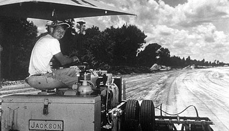 A young Bill France Jr. works on grading the land on what became the backstretch of Daytona International Speedway in 1958. France's willingness to perform all manner of odd jobs in the speedway business later served him well as NASCAR's boss.