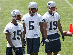 New Patriots wide receiver Randy Moss, center, with fellow wideouts Kelley Washington, left, and Kelvin Kight will attempt to revive his career in New England after two disappointing seasons in Oakland. He is part of a revamped receiving corps, which includes Wes Welker and Donte' Stallworth, that will work with Brady.