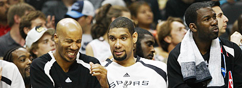 Tim Duncan, center, puts Spurs teammate Bruce Bowen, left, in stitches as Michael Finley checks out the action during the closing moments of Game 5 of the Western Conference finals May 30 in San Antonio.