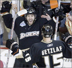 Anaheim's Andy McDonald wears the smile of a goal-scorer in the deciding game of the Stanley Cup Finals as he celebrates with Ryan Getzlaf. 