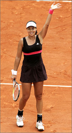 Ana Ivonovic celebrates after knocking off Maria Sharapova in the French Open. The celebration will be short-lived for Ivonovic, who must now turn her attention to a showdown with defending champion Justine Henin on Saturday.