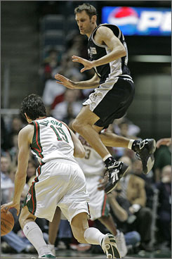 See, former NBA slam-dunk champ Brent Barry really can jump. Here, he leaps while defending Bucks forward Ersan Ilyasova on March 15 in Milwaukee.