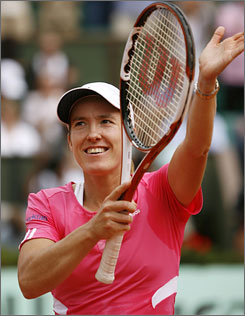 Two-time defending champion Justine Henin moved to within one win of another French Open title by beating Jelena Jankovic.