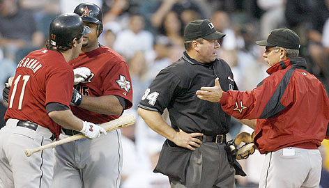 Lance Berkman, who'd already been tossed, tries to engage umpire Sam Holbrook as fellow Astro Carlos Lee holds him back. Meantime, Houston manager Phil Garner gets in a few choice words. Berkman's ejection occurred as he appeals a suspension for arguing with an umpire earlier this week.