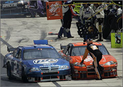 Kurt Busch, left, pulled alongside Tony Stewart's car on pit road at Dover after the two collided during the race. The parking job, and the fact he nearly hit a Stewart crewmember, cost Busch 100 driver points, a $100,000 fine and probation.