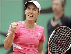 Justine Henin, shown just after defeating Jelena Jankovic in Paris on Thursday, is seeking to win the year's opening Grand Slam event for the third consecutive time. The Belgian has won 33 consecutive matches on the clay at Roland Garros.