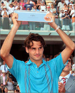 Roger Federer holds up his trophy as runner up to Rafael Nadal  a label that he seemingly winds up with every time he sets foot on clay.