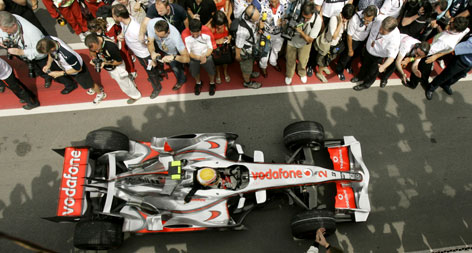 Lewis Hamilton is greeted by a crowd as he makes his first trip to Victory Lane after winning the Canadian Grand Prix