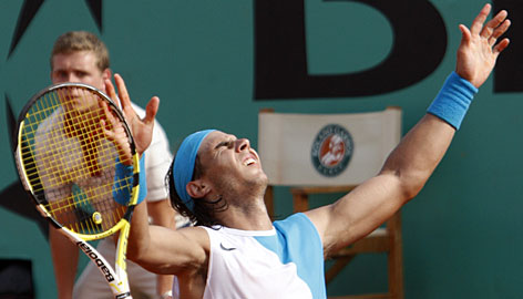 Rafael Nadal continued his dominance at Roland Garros, beating Roger Federer in four sets to claim his third consecutive French Open title.