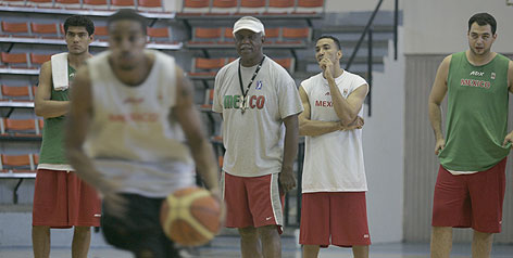 Nolan Richardson, wearing whistle and visor, is coaching Mexico's national team to what he hopes is a berth in next summer's Olympics in China. The former Arkansas and Tulsa coach features NCAA and NIT titles on his resume.
