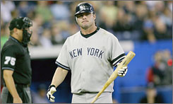 In this photo, Jason Giambi struck out against in Toronto last month. The New York Yankees DH could have his playing status curtailed if he fails to cooperate with baseball's steroid probe.