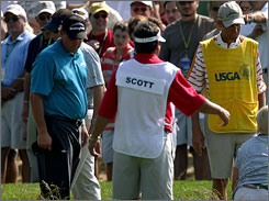 Searching for his ball on the eighth hole was one of the rough moments during Phil Mickelson's round.