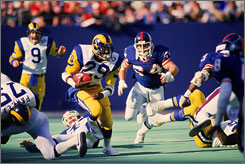 Eric Dickerson, shown in a 1985 game at Giants Stadium, set rookie records in yards rushing and touchdowns when he broke in with the Rams in 1983.