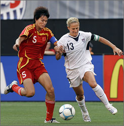 United States captain Kristine Lilly, right, battles China's Li Jie for the ball during the first half of their exhibition match leading up to September's World Cup.
