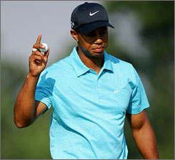 Tiger Woods had one of the day's two under-par rounds to put himself just two shots off the lead.