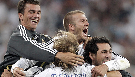 David Beckham, top right, celebrates with teammates after Real Madrid clinched its 30th Spanish league title.