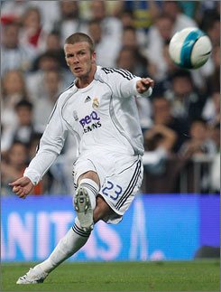 David Beckham serves up one of his trademark free kicks during Sunday's game against Mallorca. Beckham was substituted out in the 66th minute with an injury but Real Madrid managed to hold on for a 3-1 victory. Beckham is scheduled to join Major League Soccer's L.A. Galaxy in July.