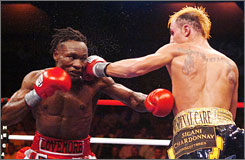 Paulie Malignaggi, right, attempts to land a left hand on Lovemore N'dou during Malignaggi's unanimous decision victory on Saturday. Malignaggi earned the IBF junior welterweight title in the match.
